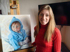 Portrait Artist Hannah Ostapjuk with A Portrait of Young Destiny
